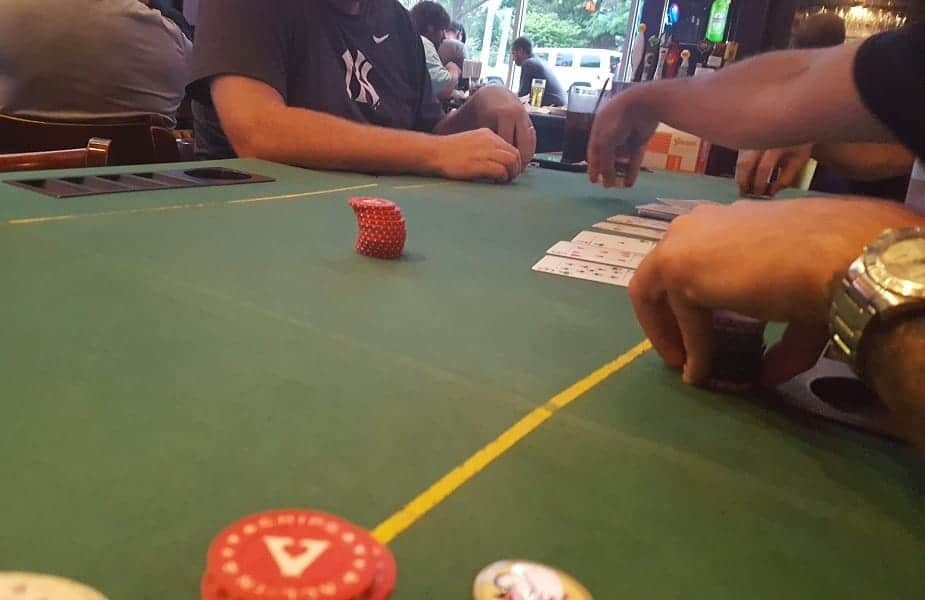 Pub Poker Opponent Making Bet