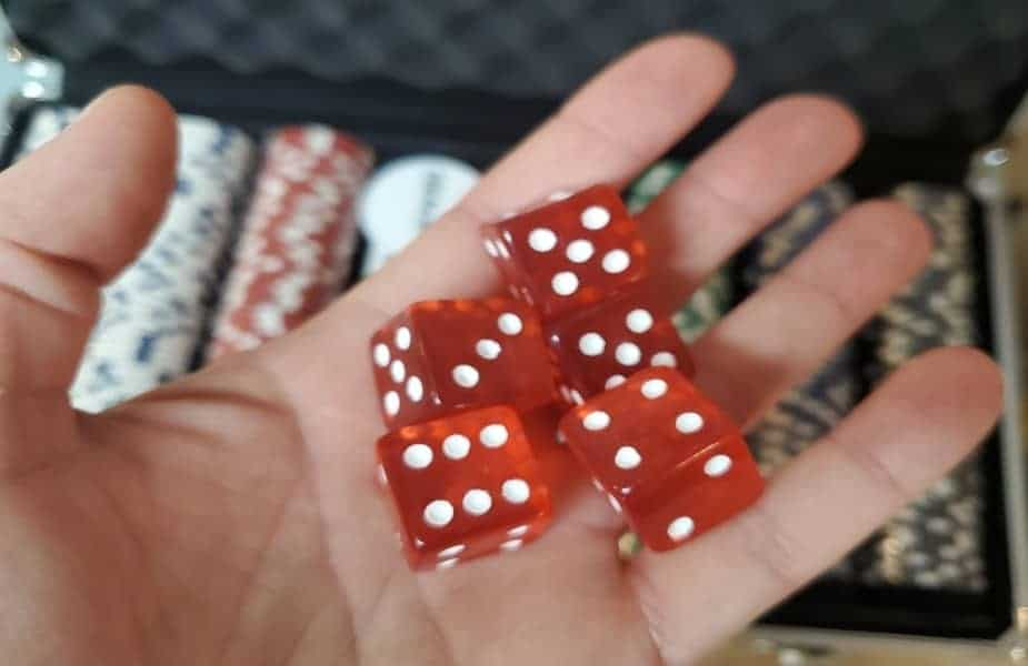 Why Do Poker Sets Come with Dice?