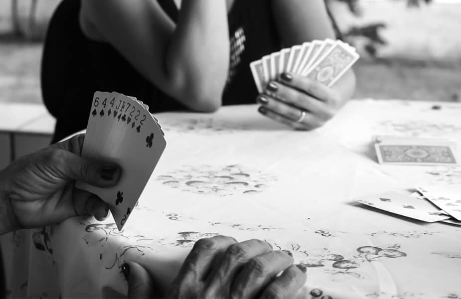 People Playing Cards at a Table